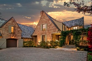 Country French style home at dusk.