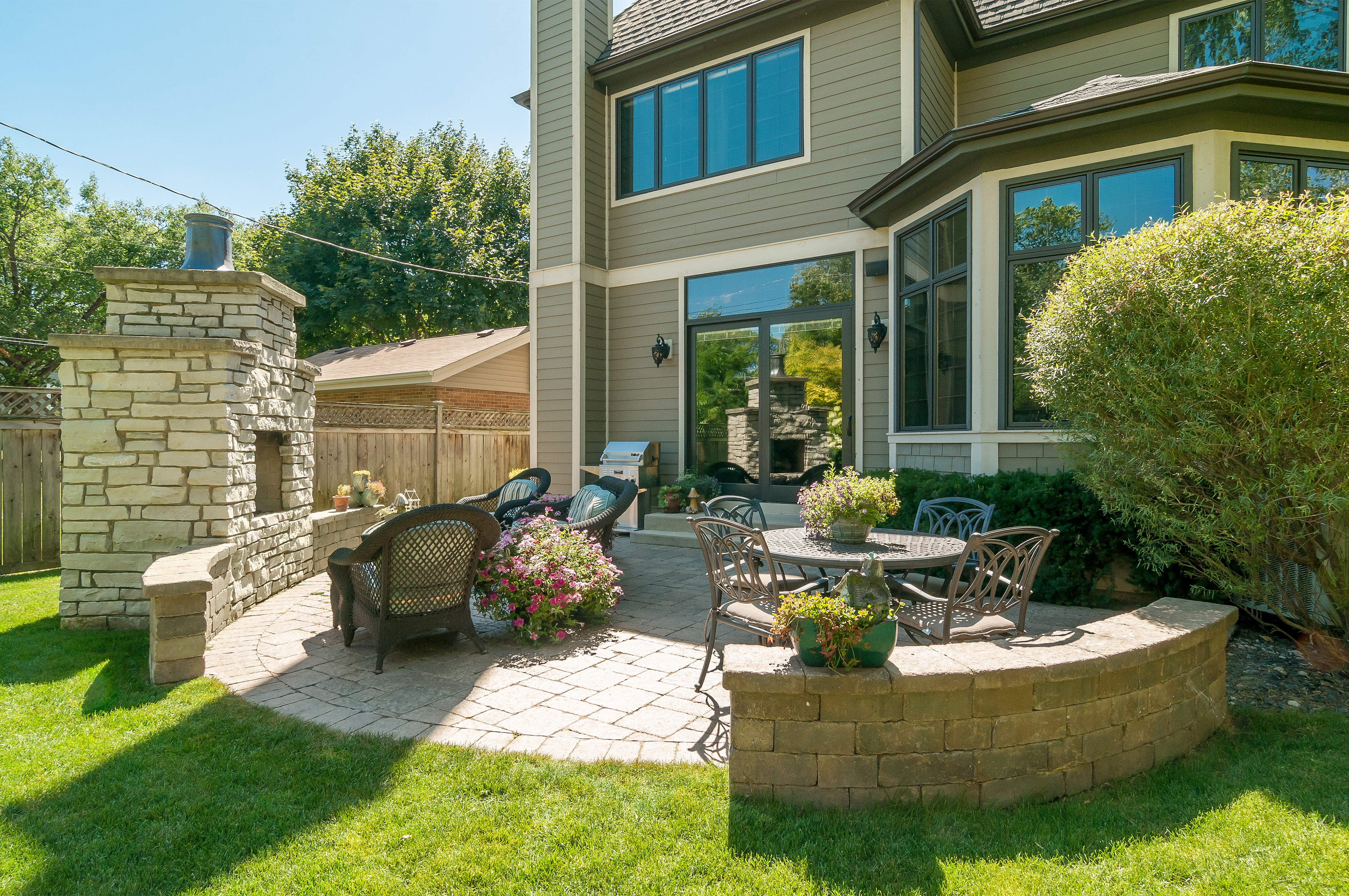 Back yard with fireplace in Naperville, IL register