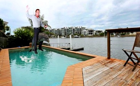 agent riding dolphin - bad real estate photo