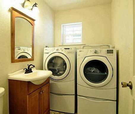 washer and dryer behind sink - bad real estate photo