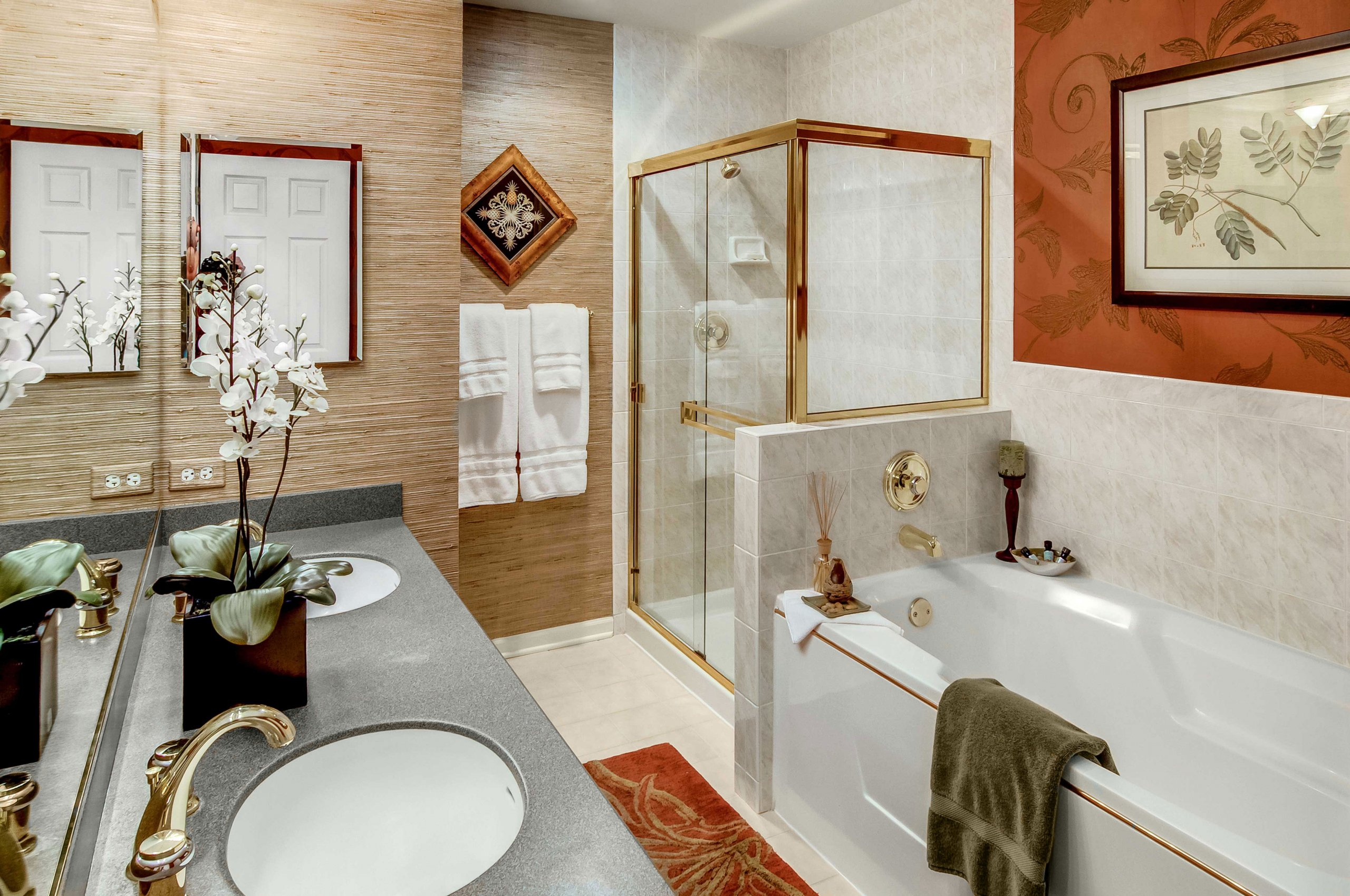 Bathroom in rust color with gold fixtures