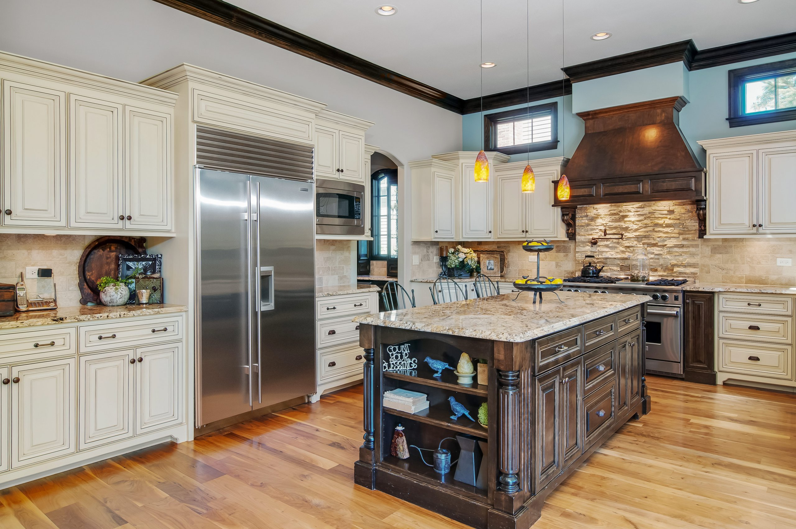 Spacious Naperville, Illinois kitchen interior photograph with high end cabinetry.