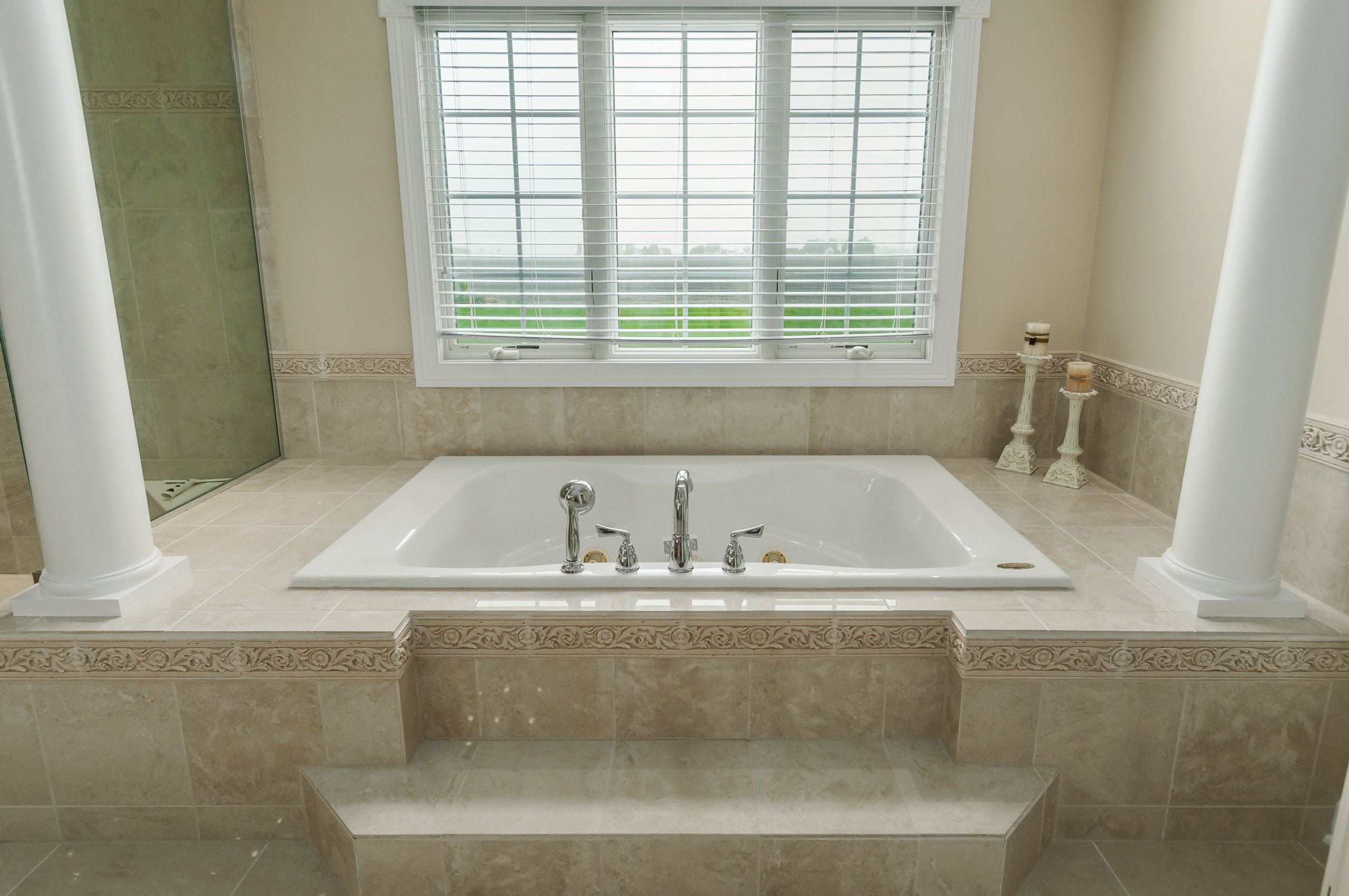 Marbled high end bathroom with columns in Somonauk, Illinois estate home.
