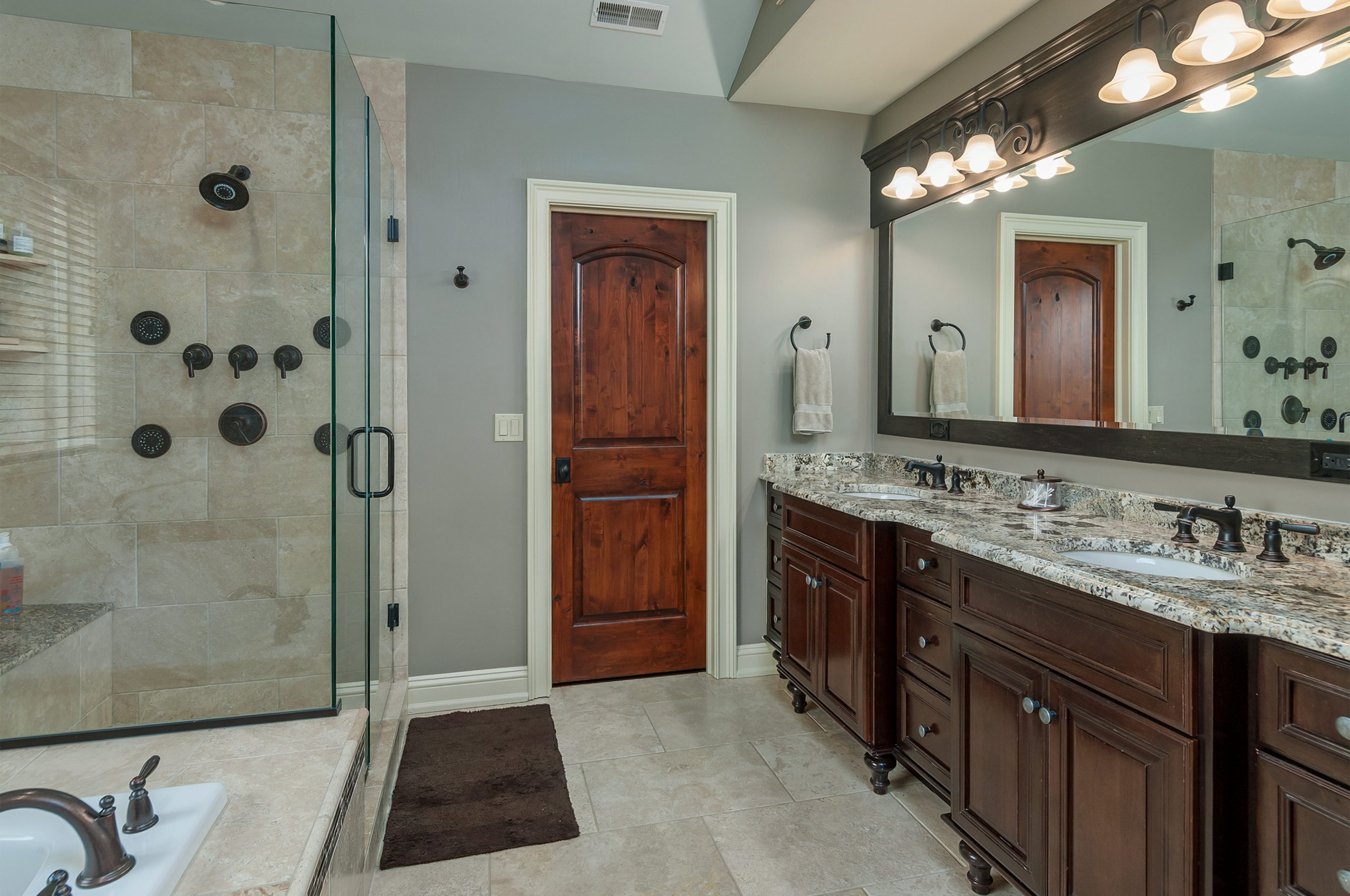 Modern, spacious master bathroom in up scale home.