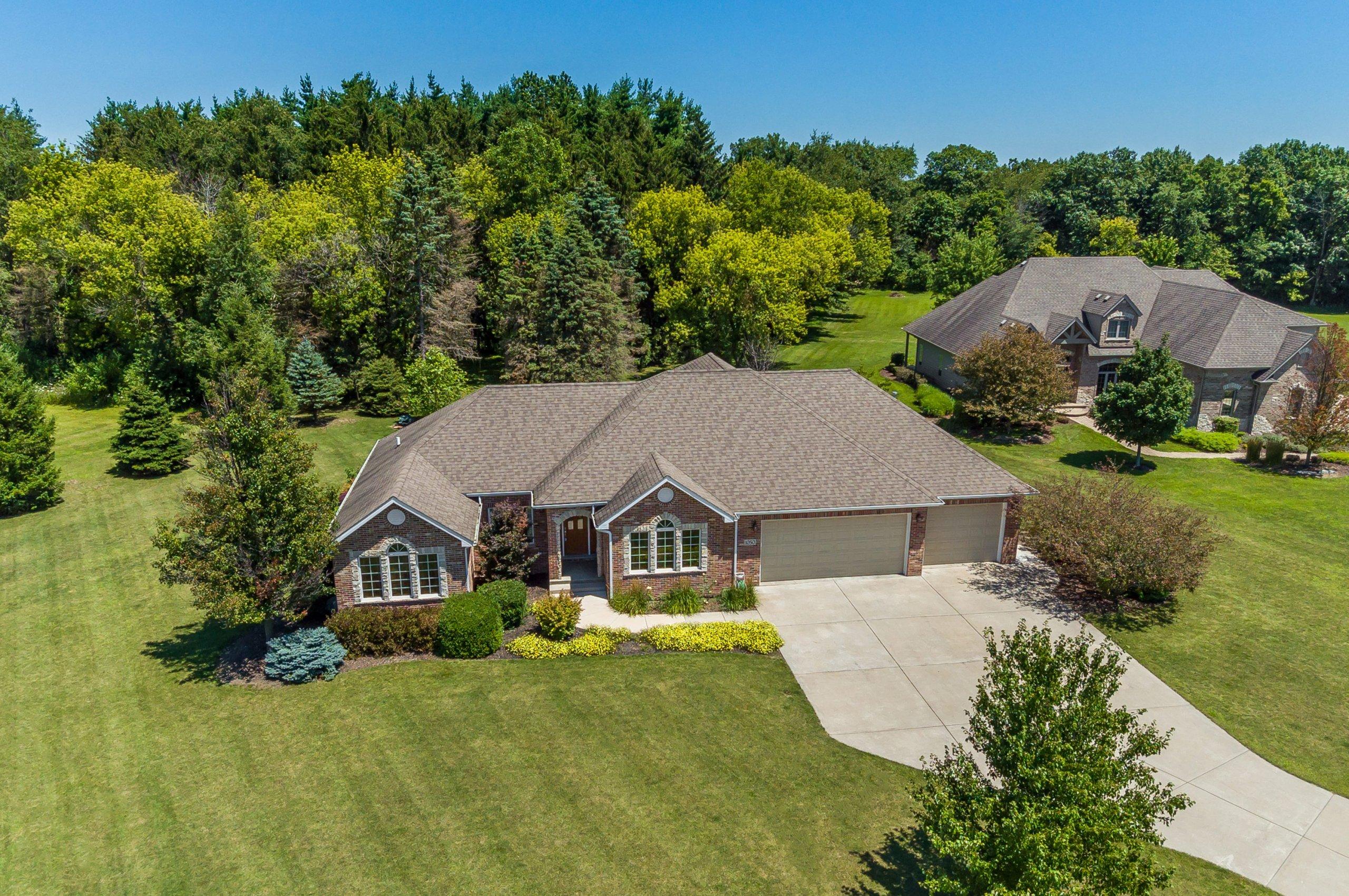 Chicago architectural and real estate drone aerial front shot of 1050 Brooks Edge Ct., Somonauk, Illinois