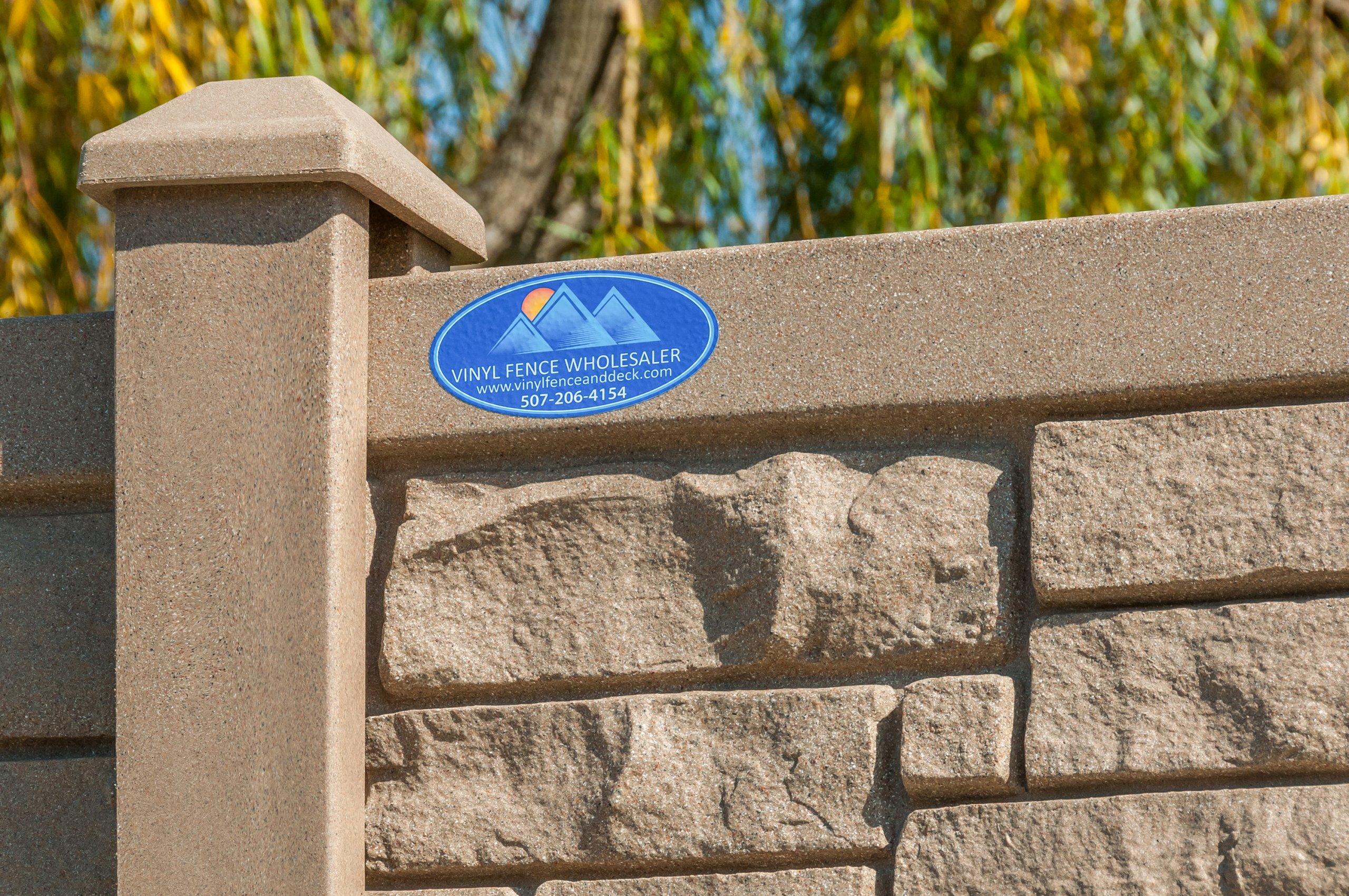 Close up of manufacturer label and logo attached to sound fence on Eola Road, Aurora, Illinois.