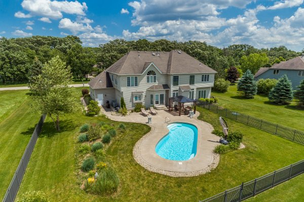 Chicago suburban real estate drone aerial view of pool and house at 4007 River Edge Ln., Sandwich, IL