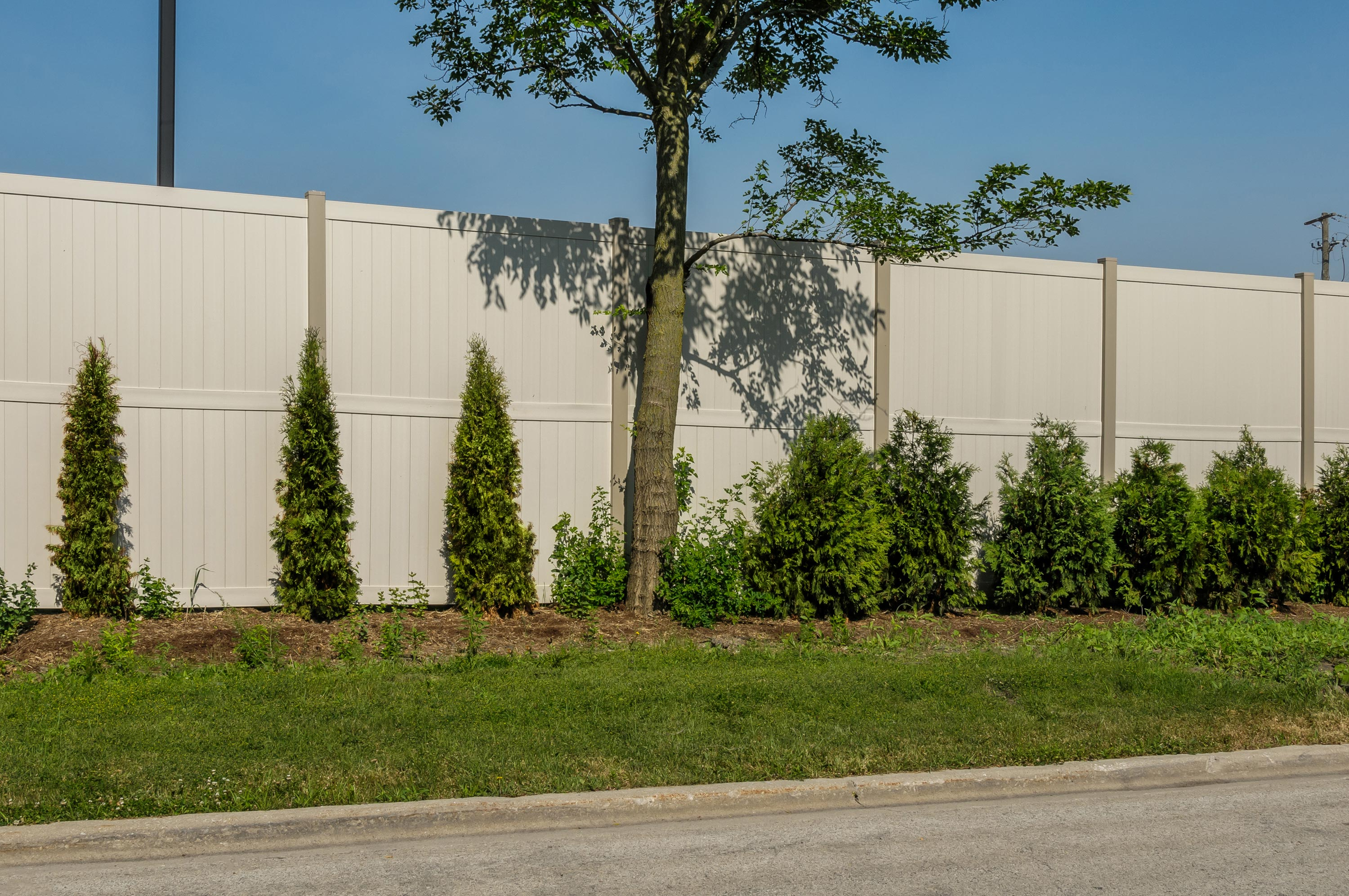 10' Rainer vinyl fence photo fence-13 installed around warehouse in River Grove, Illinois