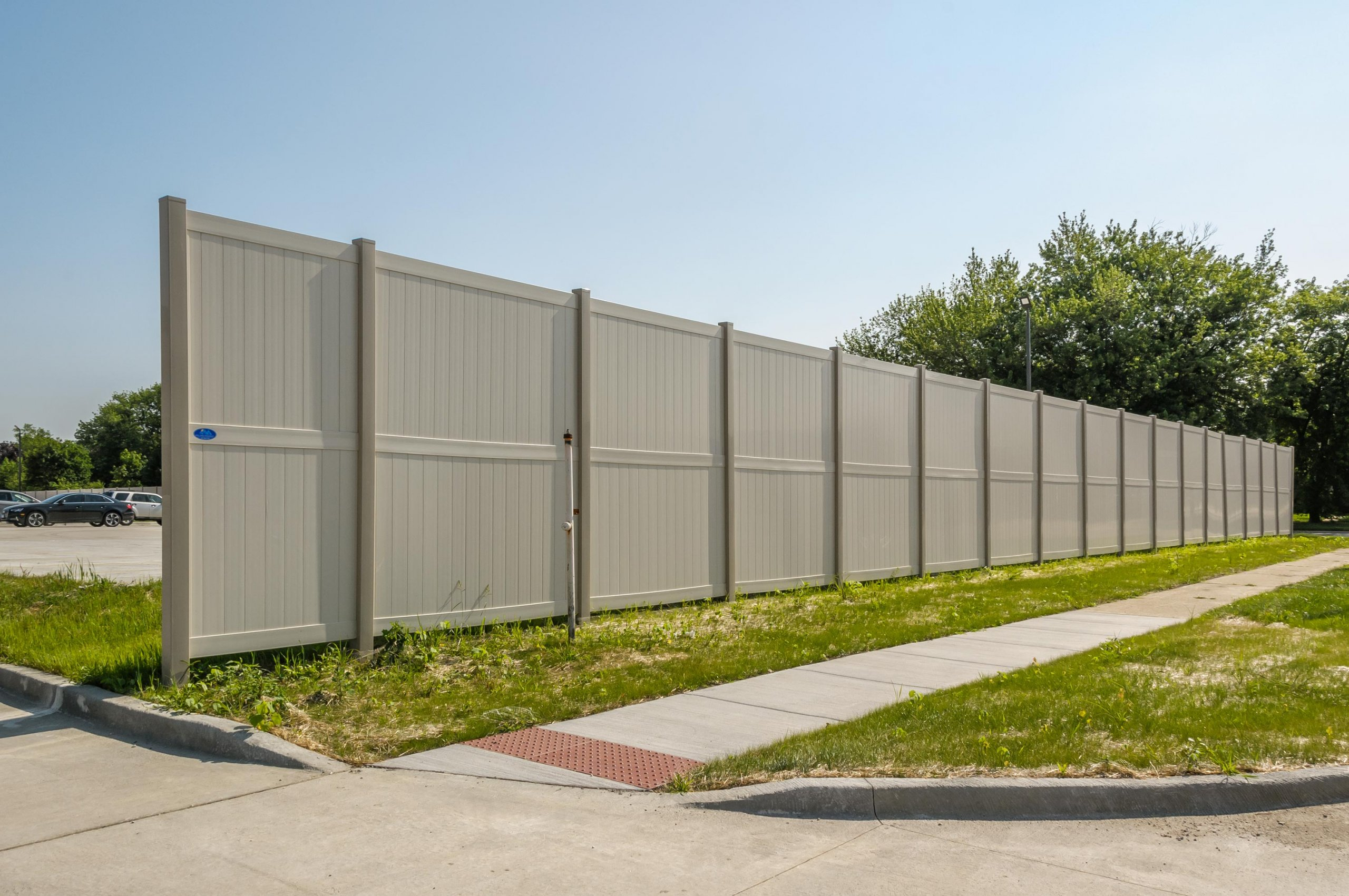10' Rainer vinyl fence photo fence-6 installed around warehouse in River Grove, Illinois