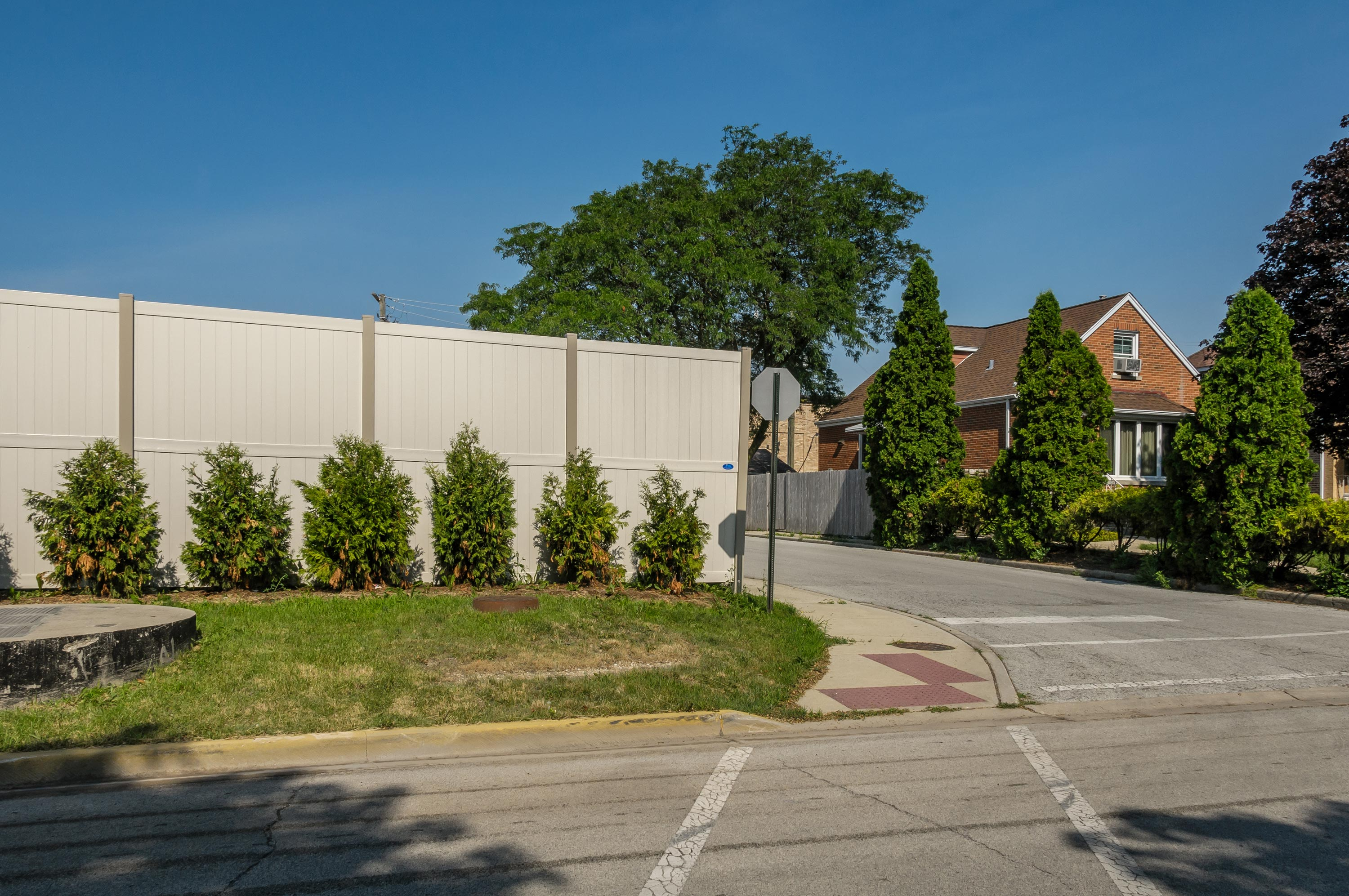 10' Rainer vinyl fence photo fence-8 installed around warehouse in River Grove, Illinois