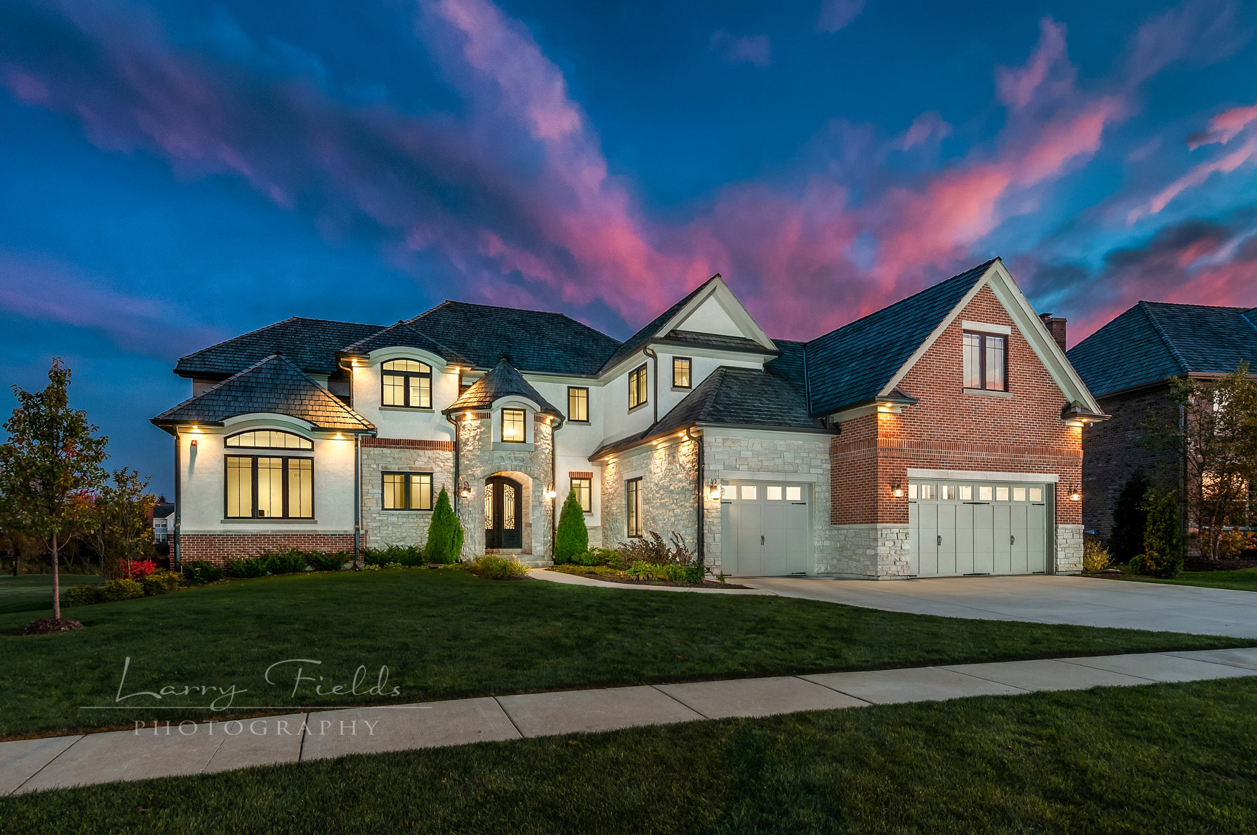 Twilight shot of 1616 Lake Charles Dr., Vernon Hills, Illinois with watermark. Twilight photograph of a high-end home.