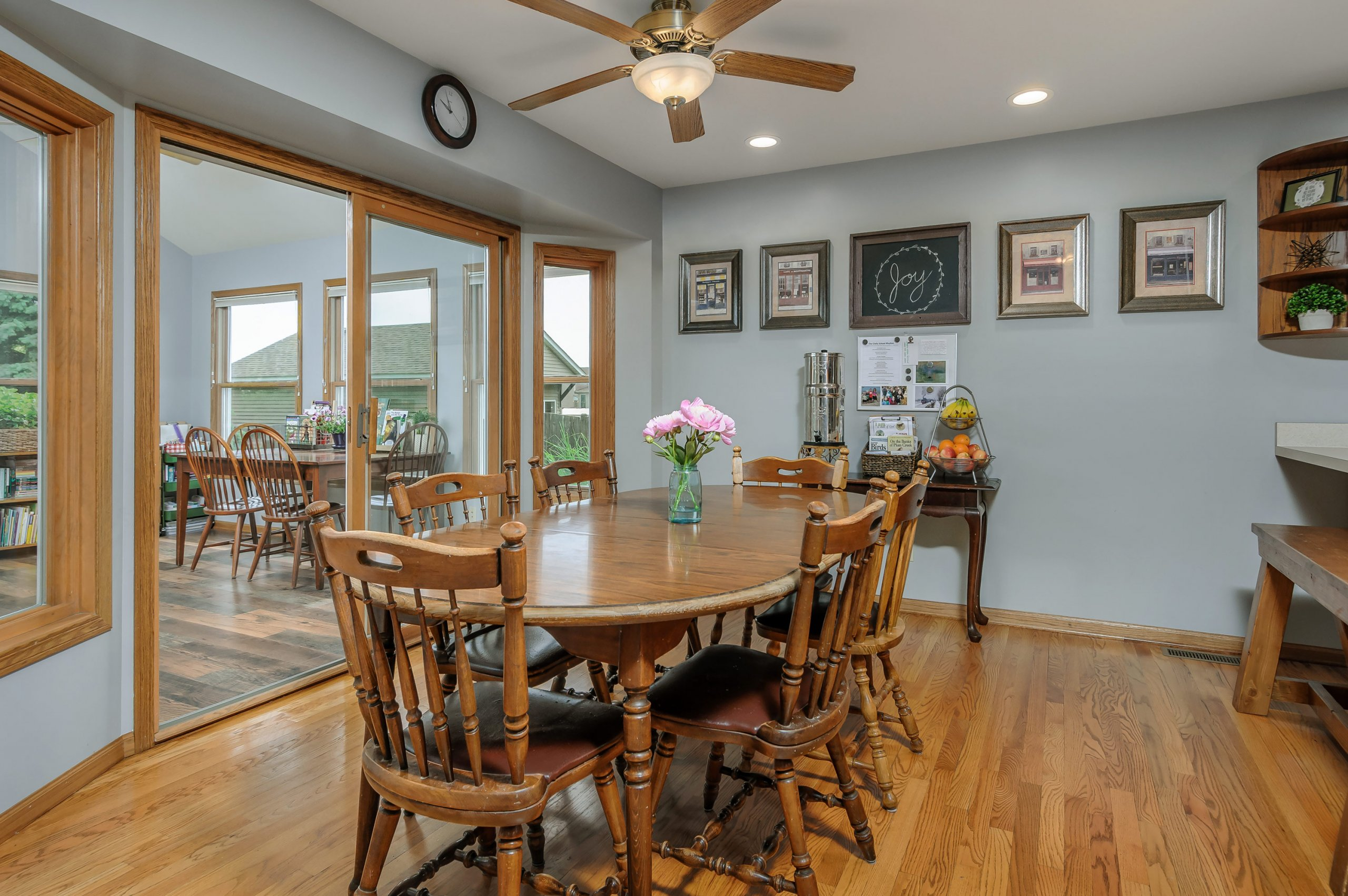 Modern, gray dinette with attached 4 season room view.