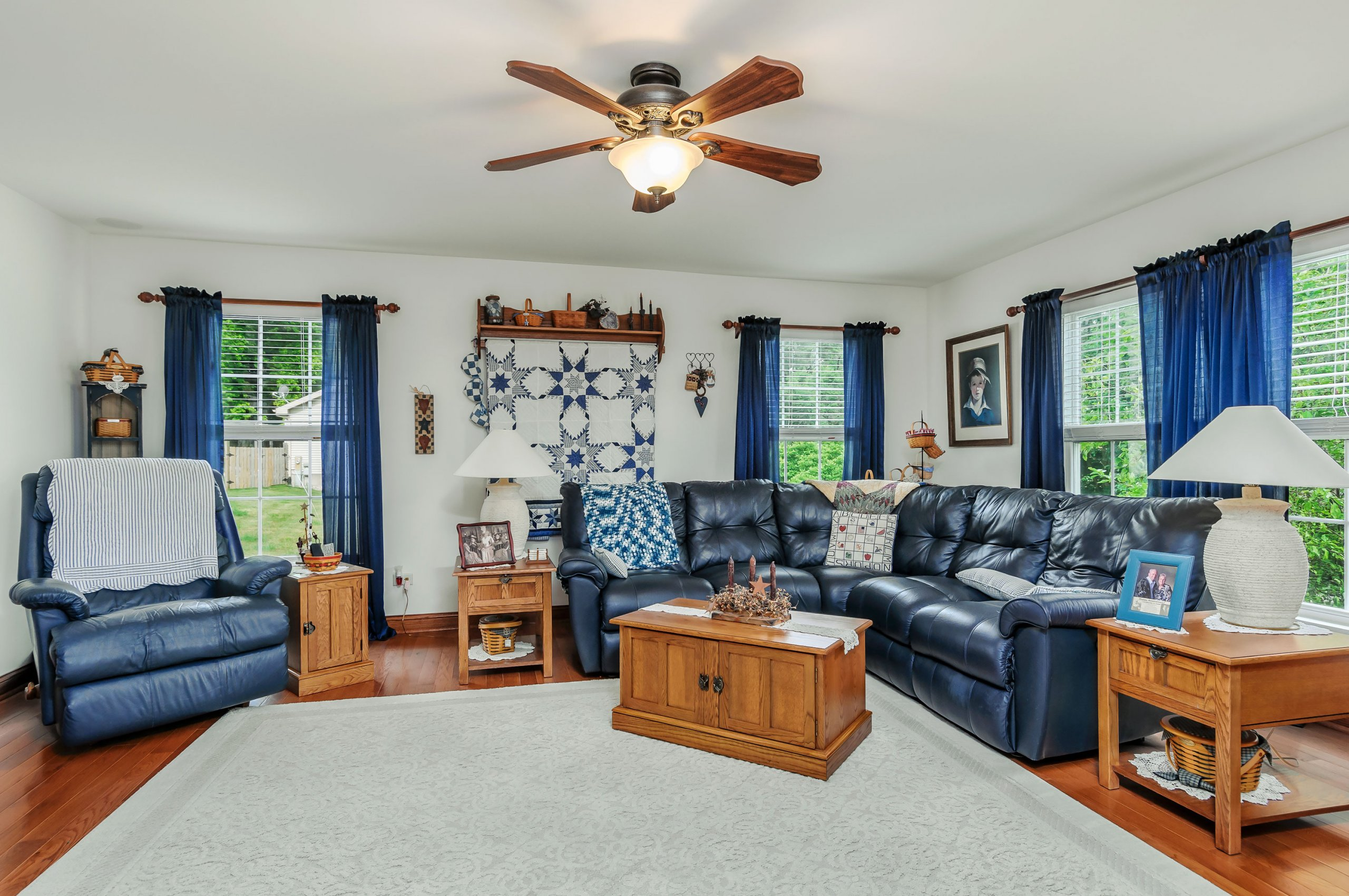 Elegant blue themed living room in Lake Holiday, Illinois.