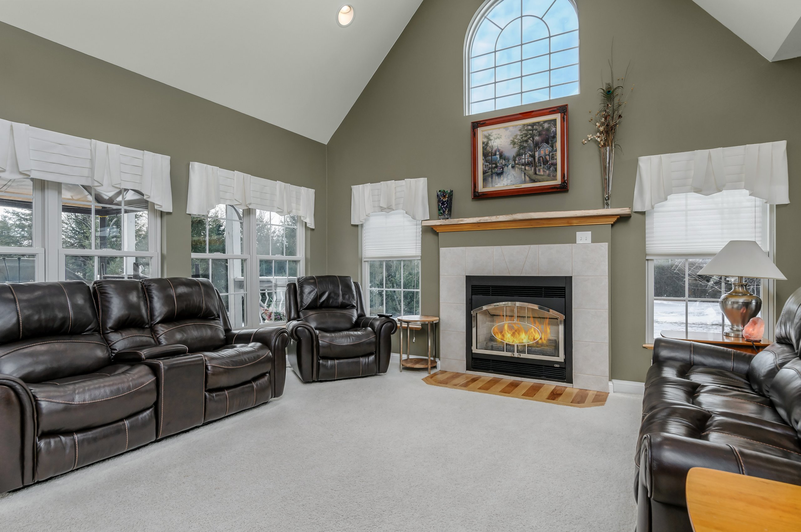 Stately living room with high vaulted ceiling in Sheridan, Illinois.