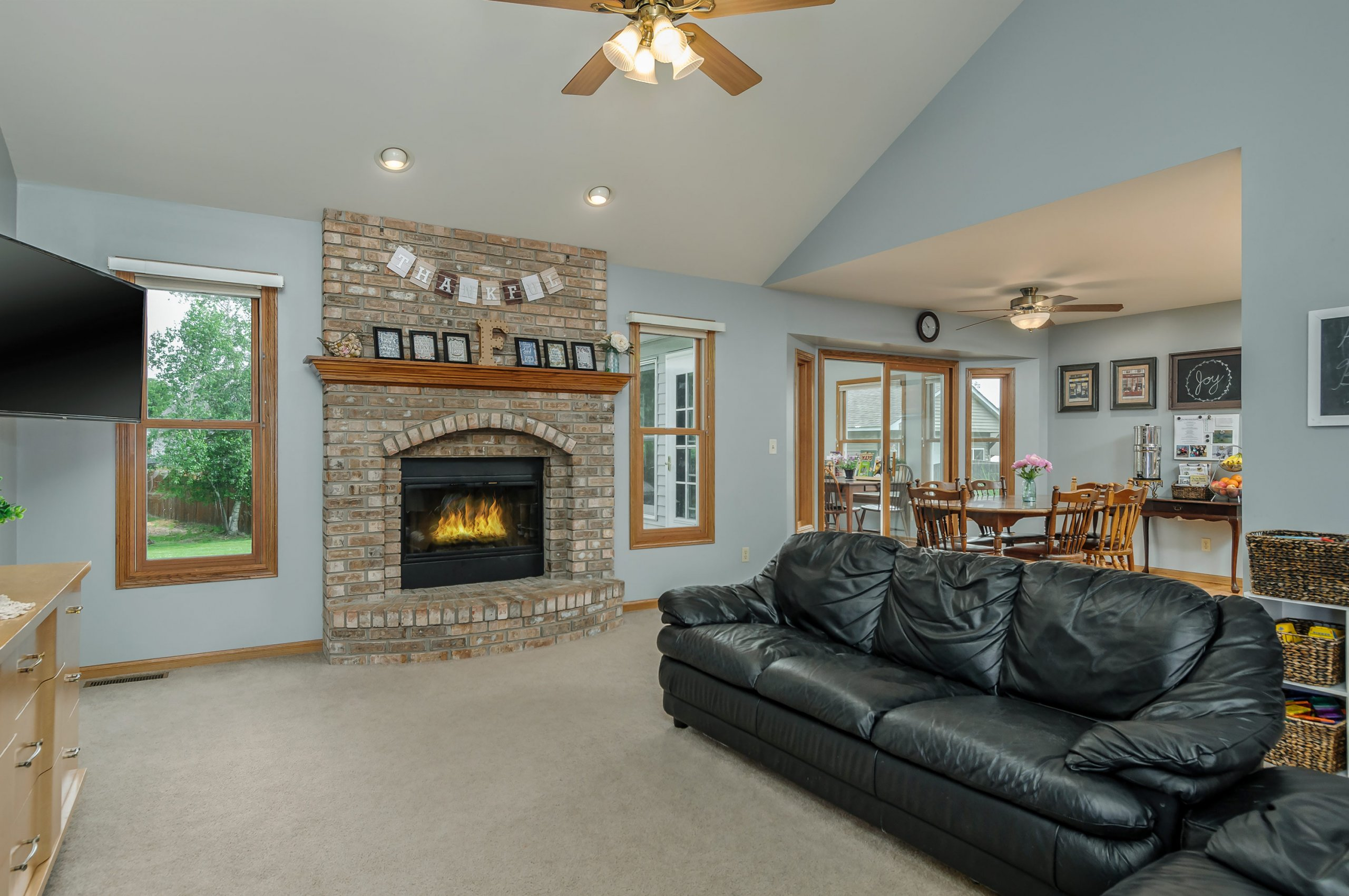 Open living room with brick fireplace - suburban Chicago, Illinois.